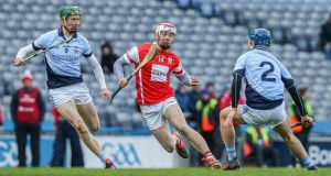 Cuala's Con O'Callaghan in action against Na Piarsaigh's William O'Donoghue and   Jerome Boylan during the All-Ireland club hurling final at Croke Park. Photograph: Gary Carr/Inpho