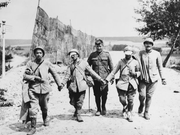 French infantrymen, blinded probably by gassing, are escorted by a British soldier after the second battle of the Marne during the second World War. Photograph: Hulton-Deutsch Collection/Corbis via Getty Images