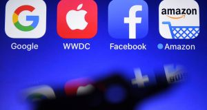 It's clear that a way needs to be found to get a fairer contribution in corporate tax from big multinational players in the digital sector such as Apple, Google and Facebook. Photograph: Damien Meyer/AFP/Getty Images