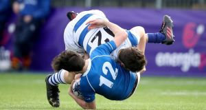 St Mary's Barra O'Loughlin is tackled by Ben Brownlee of Blackrock. Photograph: Oisin Keniry/Inpho