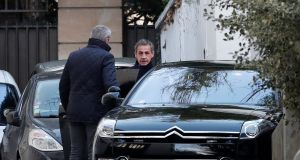 Former French president Nicolas Sarkozy  leaves his house in Paris on Wednesday. Photograph: Benoit Tessier/Reuters