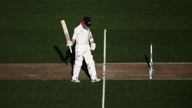 Kane Williamson of New Zealand acknowledges reaching his half century. Photograph: Anthony Au-Yeung/Getty