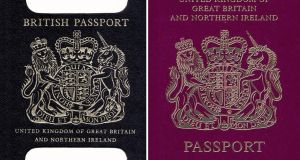An old British passport and a burgundy UK passport in the EU format. The planned new post-Brexit blue passport is seen by  Brexiteers see as a symbol of the UK's regained independence. Photograph:  PA Wire