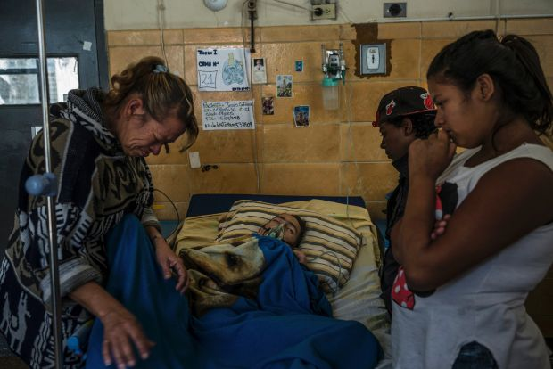 Jesús Contreras, (29), with family and friends in the tuberculosis ward of the Dr José Ignacio Baldó Hospital in Caracas last month.