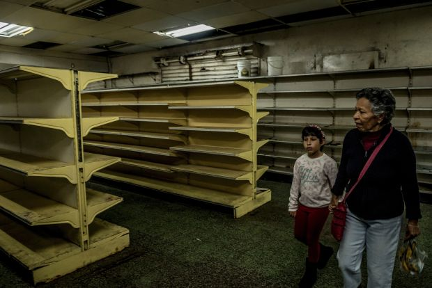 Food shortages have led to empty supermarket shelves in Venezuela, including these in Guaicaipuro.