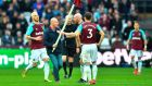 James Collins confronts a pitch invader during West Ham's defeat to Burnley. Photograph: Ben Stansall/AFP
