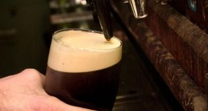 Pouring a pint of Guinness: the two-part pour is a cod. Photograph: Dara MacDonaill