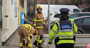 Members of Dublin Fire Brigade and gardaí at the scene of the fire at the Metro Hotel, Ballymun, Dublin,  on Thursday morning. Photograph: Colin Keegan/Collins Dublin