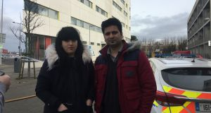 Anita Doktere (left) and her partner Adeel Bashir at the scene of the fire on Thursday morning. Photograph: Mark Hilliard