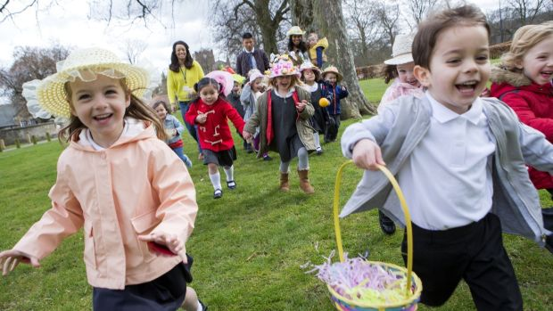 Children run across a field during an Easter egg hunt. File photograph: Getty Images
