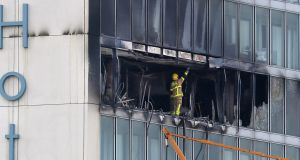 A firefighter surveys the damage at the scene of the at the Metro Hotel, Ballymun after Wednesday night's fire. Photograph:  Colin Keegan, Collins Dublin