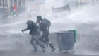 Police use water cannons as thousands protest in Paris