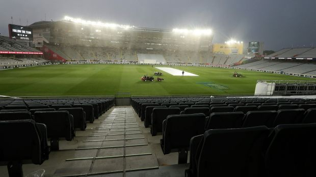 Rain brought a premature end to day two at Eden Park. Photograph: Fiona Goodall/AFP