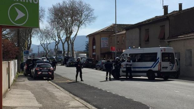 Police at the scene of a hostage situation in a supermarket in Trebes. Photograph: La Vie A Trebes/via Reuters