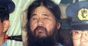 Shoko Asahara following an interrogation in Tokyo in 1995. Thirteen Japanese cult members may be sent to the gallows for an attack on the Tokyo subway system and other crimes. Photograph: Kyodo News/AP