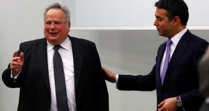 Macedonian foreign minister Nikola Dimitrov (right) meets with Greek foreign minister Nikos Kotzias in Skopje, Macedonia, on Friday. Photograph: Ognen Teofilovski/Reuters