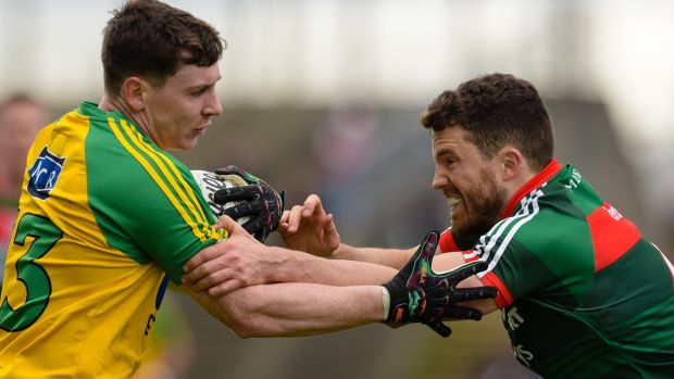 Donegal's Jamie Brennan is tackled by Mayo's Chris Barrett. Photograph: Tom Beary/Inpho