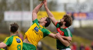 Donegal's Michael Murphy and Mayo's Aidan O'Shea battle for possession  in last year's league clash in Castlebar . Photograph: Tom Beary/Inpho