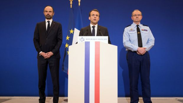 French president Emmanuel Macron delivers a speech at the Ministry of the Interior in Paris attended by prime minister Edouard Philippe and director general of the Gendarmerie Nationale Richard Lizurey after a hostage situation in a supermarket in the village of Trebes. Photograph: Philippe Wojazer/Reuters