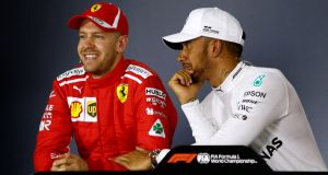 Lewis Hamilton and Sebatian Vettel during the post-qualifying press conference at the Melbourne Grand Prix. Photograph:  Brandon Malone/Reuters