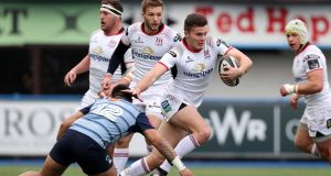 Ulster's Jacob Stockdale tries to evade the tackle of Cardiff's  Willis Halaholo during the Guinness Pro 14 game at  BT Sport Cardiff Arms Park. Photograph:  Billy Stickland/Inpho