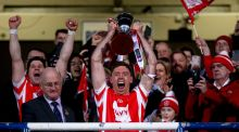 Paul Schutte lifts the trophy after Cuala's All-Ireland win. Photograph: James Crombie/Inpho