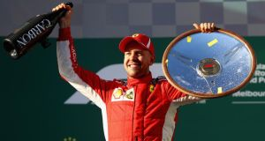 Sebastian Vettel celebrates his Melbourne Grand Prix victory. Photograph: Mark Thompson/Getty