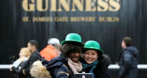 Tourists take a selfie  at one of the Guinness gate's in Dublin. Photograph:   Brian Lawless/PA Wire