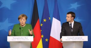 Germany's chancellor Angela Merkel with French president Emmanuel Macron: expressed solidarity with Britain days after the attack. Photograph:  AFP/Getty Images