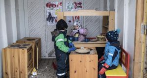 Boys and girls at play in an outdoor toy kitchen at a preschool in Sweden. Photogaph: Andrea Bruce/The New York Times