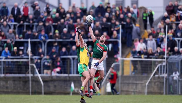 Mayo's Séamus O'Shea gets to the ball ahead of Donegal's Michael Murphy during the Allianz Football League Division One game at MacCumhaill Park in Ballybofey. Photograph: Tommy Dickson/Inpho
