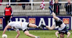 Frankie Burke of Galway and Kildare's Peter Kelly go their separate ways during the Allianz Football League Division One game at St Conleth's Park in Newbridge. Photograph: Laszlo Geczo/Inpho