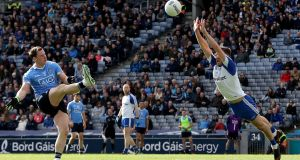 Ryan Wylie of Monaghan attempts to block Dublin's Philly McMahon during the Allianz Football League Division One game at  Croke Park. Photograph: Bryan Keane/Inpho