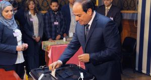 Egyptian president Abdel Fattah al-Sisi casting his ballot during the first day of the presidential election at a polling station in Cairo on Monday. Photograph:  EPA/Egyptian Presidency