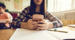 Many students are checking their devices in class on a regular basis, research shows. Photograph: Istock