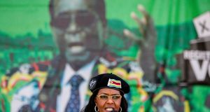 "Grace Mugabe: has been nicknamed ""Gucci Grace""and her wealth has prompted questions as to its provenance and suspicions of her involvement  in illegal activities. Photograph:  Zinyange Auntony/AFP/Getty Images"