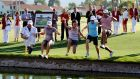 Who will be jumping into the pond surrounding the 18th green, known as Champion's Lake (or Poppie's Pond) this year. Photograph: Getty Images