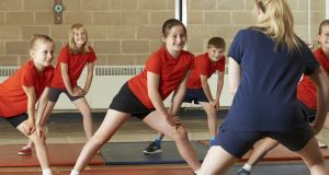 PE class: many schools say they lack adequate sports facilities. Photograph: Getty