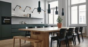 Joanna Laajisto: Natural, bare woods and forest shades inform this kitchen at creative agency Fjord.