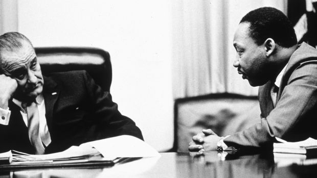 President Lyndon B Johnson and Martin Luther King discuss the Voting Rights Act in 1965. Photograph: Hulton Archive/Getty Images