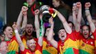 Carlow's Richard Coady and Diarmuid Byrne lift the trophy after winning the Division 2A hurling league final. Photograph: James Crombie/Inpho
