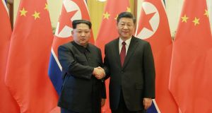 Kim Jong-un (L) shakes hands with Chinese president Xi Jinping, as he paid an unofficial visit to Beijing in this undated photo released by North Korea's Korean Central News Agency (KCNA).  Photograph: KCNA/Reuters