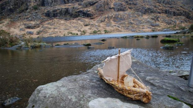 Billy Mag Fhloinn and his wife Muireann Nic Amhlaoibh sent a lit candle in a small boat onto a lake in Kerry to mark the birth of their daughter Sadhbh.