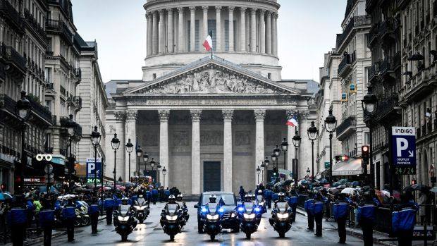 Gendarmes escort the coffin of the late Lieutenant Colonel Arnaud Beltrame in front of the Pantheon in Paris. Photograph: Stephane De Sakutin/AFP/Getty Images