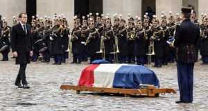 French president Emmanuel Macron  walks towards the coffin of Arnaud Beltrame at the Hótel des Invalides in ParisPhotograph: Ludovic Marin/Pool via Reuters