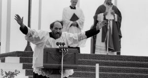 Fr Michael Cleary gives a warm-up address to the audience before Pope John Paul II celebrates a Young People's Mass in Ballybrit, Galway, in October 1979.