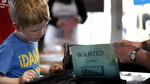 "A young attendee watches ""Wanted"" being created the National Print Museum"
