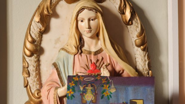 The Virgin Mary was a gift and Niamh McCann hangs Mexican votives from it. In Mexico these little features are painted as pleas to the saints or the gods or the Marys.