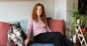Artist Niamh McCann with Sophie  in her D8 home. Photograph: Eoin Rafferty