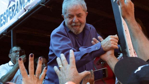 Brazil's former president Luiz Inacio Lula da Silva greets supporters during a rally in Francisco Beltrao, Parana state, Brazil, on Monday. Photograph: Eraldo Peres/AP